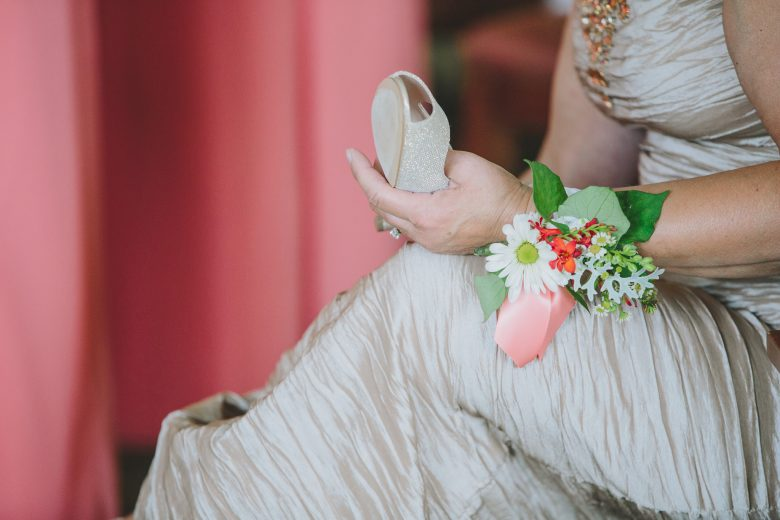 bride holding shoe
