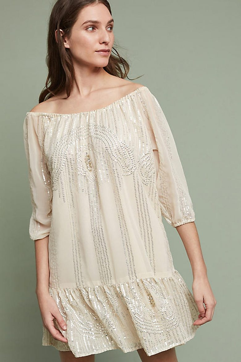 boatneck cream dress with silver sequins on woman