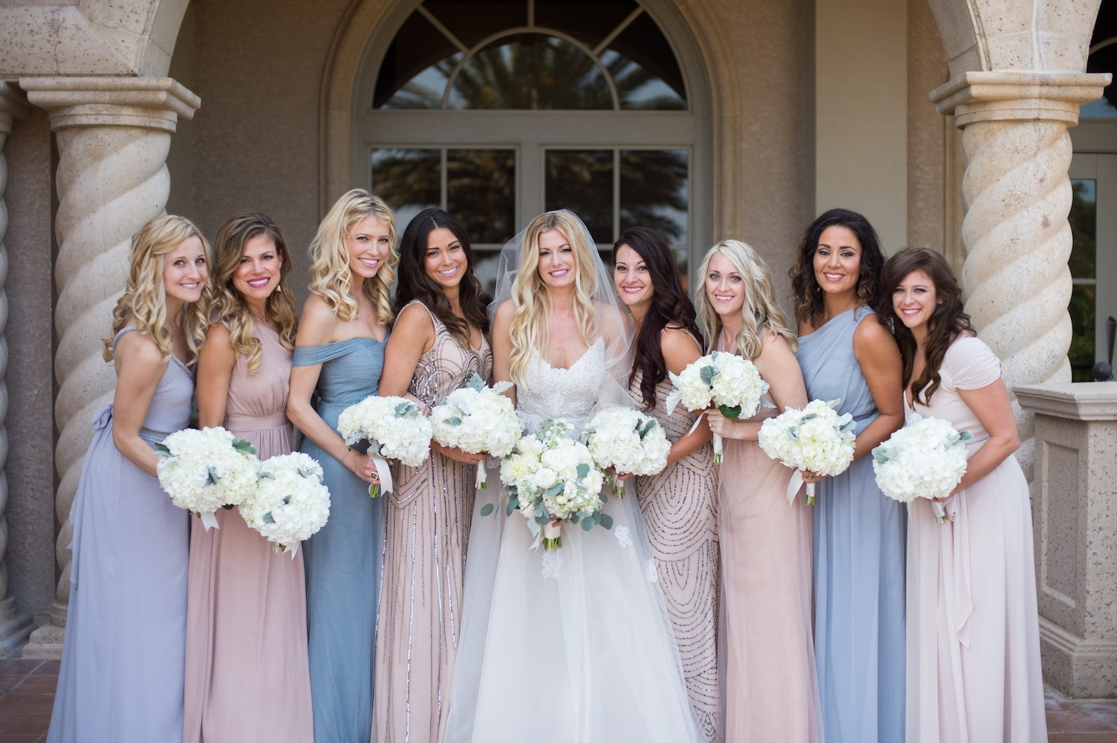 Mismatched bridesmaid dresses the easy way a practical wedding bridesmaids wearing mismatched bridesmaid dresses in cornflower blue and blush and sequins ombrellifo Gallery