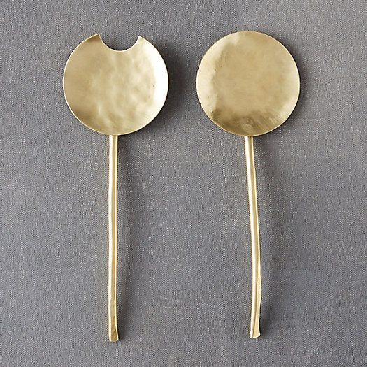 brass serving utensil pair on grey counter
